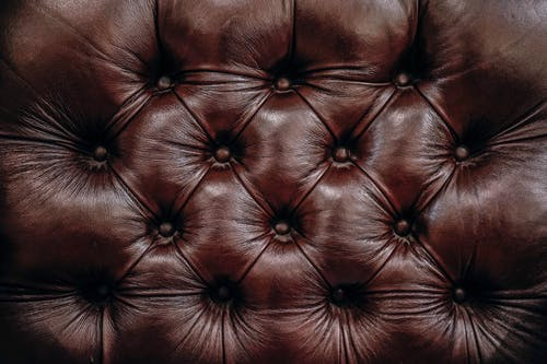 Image of a chair back with a tufted pattern.