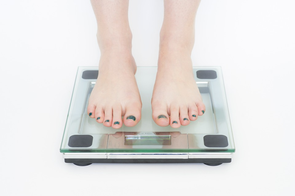 image of woman on a weight scale