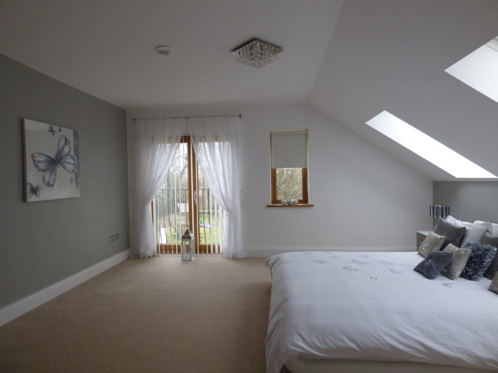 Image of bedroom with sloped ceiling