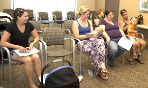 Image of women setting in chairs.