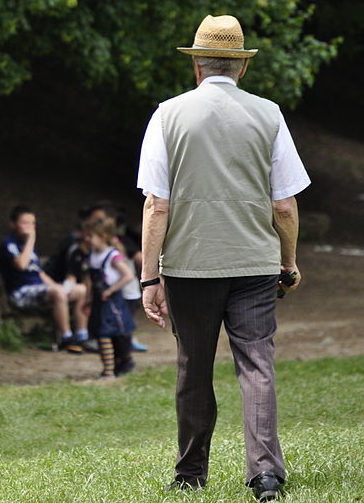 An old man walking in the park