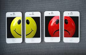 Image of yellow smiley face next to a red frowning face.